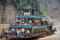 Tourists on boat at Qutang gulches at three gorges at yangtze river
