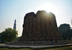 Qutb Minar along with the incomplete Alai Minar. Royalty Free Stock Photo