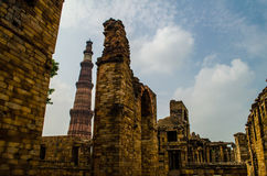 Qutb Minar and the ancient ruins. The tallest brick minaret in the world ( 72.5 metres (239 ft)) inspired by the Minaret of Jam in Afghanistan, it is an Stock Images
