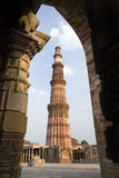 Qutb Minar -  Delhi - India. The Qutb Minar (Victory Tower) in the Quwwat-ul-Islam Mosque within the Mehrauli Archaeological Park in Delhi in India. Built in Stock Images