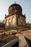 Qutb Shahi Tombs, Hyderabad. Qutb Shahi Tombs with granite blocks for restoration in foreground, Near the Golconda fort, Hyderabad, Andhra Prades, India Stock Photography
