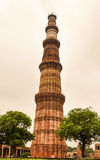 Qutub Minar. Built of red sandstone and standing about 73 meters high, this view of the Qutub Minar amazes every visitor to Delhi in India royalty free stock photo