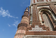 Qutub Minar and intricate inlay work on Alai Darwaza inside Qutb complex in Mehrauli Stock Image