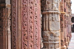 Qutub minar8. The Qutub Minar is made of red sandstone covered with intricate carvings and verses from the Qur'an. It is built by Qutub-ud-din Aibak. Numerous Stock Photo