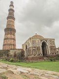 Qutub Minar with mosque. Qutub Minar, famous minaret in India with an adjacent mosque Royalty Free Stock Images