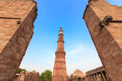 Qutub Minar. The tallest minaret in India is a marble and red sandstone tower that represents the beginning of Muslim rule in the country royalty free stock image