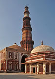 Qutub Minar and Tomb of Imam Zamin. The view includes 3 important structures at the complex with tomb of Imam Zamin (a reverred holy man) in the foreground, Alai Royalty Free Stock Images