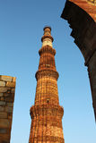 Qutub minar with walls Royalty Free Stock Photos