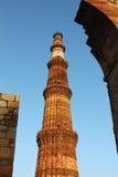 Qutub minar with walls Royalty Free Stock Photos