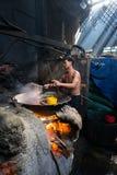 Quy Nhon, Vietnam - Oct 22, 2016: Seafood processing at fish market in Quy Nhon, south Vietnam. Fresh fish or shrimp boiling on bi Royalty Free Stock Image