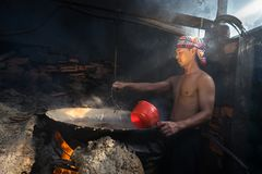 Quy Nhon, Vietnam - Oct 22, 2016: Seafood processing at fish market in Quy Nhon, south Vietnam. Fresh fish or shrimp boiling on bi Royalty Free Stock Photography