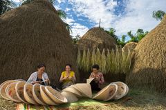 Quy Nhon, Vietnam - Oct 22, 2016: Women making conical hat in village in Quy Nhon.  Royalty Free Stock Photography