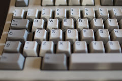 QWERTY Button on old keyboard with mechanical buttons of ivory a. Nd gray color. Computer from 90s royalty free stock images