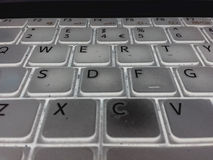 Qwerty keyboard. Close up inverted image of a laptop royalty free stock photos