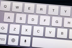Qwerty keyboard. In electronic device close up Stock Photos
