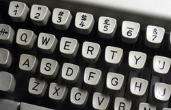 Qwerty keys. A close up of qwerty keys of typewriter stock image