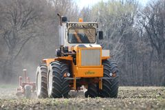 Rába Huntractor articulated tractor preparing field in Hungary royalty free stock photo