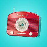 Rádio retro vermelho no fundo azul Imagens de Stock