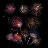 10 ráfagas del fuego artificial en negro Imagen de archivo libre de regalías
