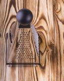 Râpe de pyramide sur la table en bois Images stock