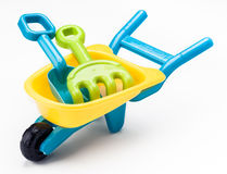 Râteau de pelle et jouet de brouette images libres de droits