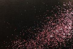 Różana złocista błyskotliwość na czarnym tle, odgórny widok obrazy stock