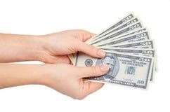 Ręka z USA dolarami, pojęciem łapówki i korupcją, fotografia royalty free