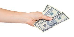 Ręka z USA dolarami, pojęciem łapówki i korupcją, zdjęcie royalty free