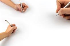 Räcka den hållande pennan, fastställt som isoleras på vit Arkivfoto