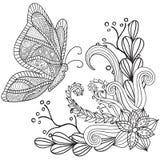 Räcka den utdragna konstnärliga etniska dekorativa mönstrade blom- ramen med en fjäril arkivfoto