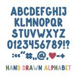 Räcka det utdragna engelska alfabetet, skiljetecken och nummer Arkivfoton