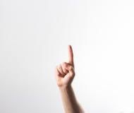 Räcka fingret som pekar uppåt isolerat på en vit bakgrund, i a royaltyfria foton