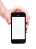 Räcka hållande Apple iPhone 5 med tomt avskärmer arkivfoto