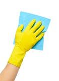 Räcka i gul handske med snyltar Royaltyfri Fotografi