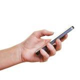Räcka innehav en smartphone Arkivfoto