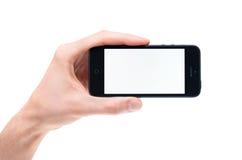 Räcka innehav tom Apple iPhone 5 Fotografering för Bildbyråer