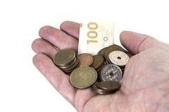 Räcka med danska pengar Arkivfoto