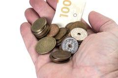 Räcka med danska pengar Arkivfoton