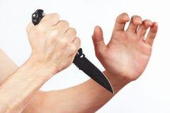 Räcka positionen för försvaret med en armékniv på vit bakgrund Royaltyfria Bilder