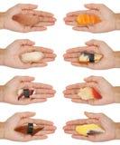 räcka ut sushi Arkivbild