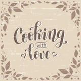 Räcka utdragen bokstäver av matlagning med förälskelse i brunt som dekoreras med hjärtor på bakgrund som stiliseras som tegelsten arkivfoto