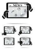 Räcker hållande tabletPC med nyheterna. Arkivbild