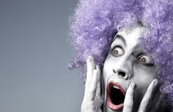 rädd clown arkivfoto