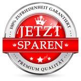 Räddning nu garanterad tillfredsställelse 100% - tysk etikett Arkivbild