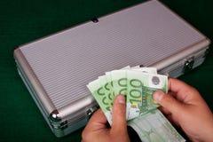 räkna euros Arkivfoto