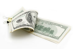 räkning för dollar 100 med ett gem på en vit bakgrund Royaltyfria Foton