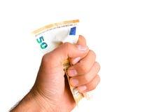 Räkning för euro femtio i en hand Arkivfoton
