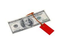 räkning för $ 100 med en röd etikett Arkivbild
