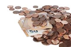 Räkningar av femtio euro och mynt Fotografering för Bildbyråer