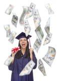 Räkningar för innehav $100 för kvinnlig doktorand- med många som faller runt om henne Royaltyfria Bilder